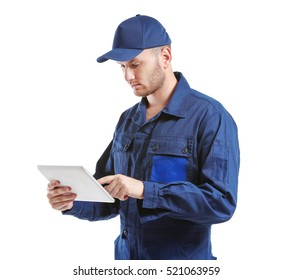 Young mechanic in uniform with a tablet standing, isolated on white