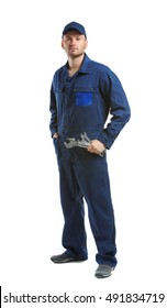 Young mechanic in uniform with wrenches standing, isolated on white
