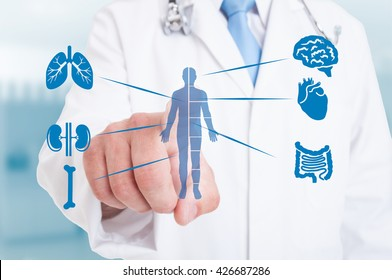 Young medic pointing on modern hologram with internal organs as good function and healthy organism concept