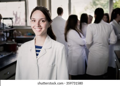 Young medicine developer pharmaceutical researcher. Woman genius chemist. University professor.Intern. Developing new medicine for psychosis and depression in laboratory with herbal extraction. Drugs