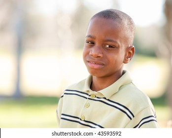 Young Melancholy African American Boy in The Park.
