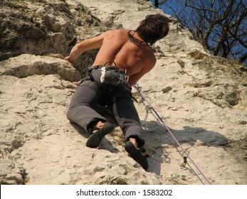 Young men climbing and looking after a good grip, ?rni Kal, Slovenia