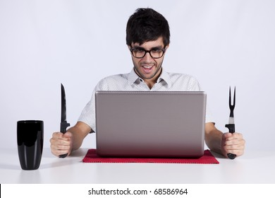 Young men at dinner table eating technology