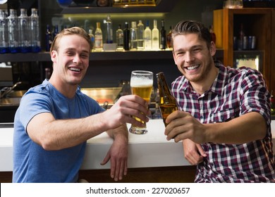 Young men drinking beer together at the bar