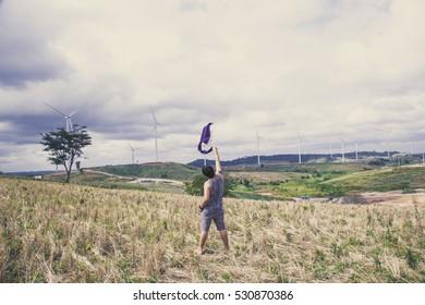 Young men enjoy the scenery wind turbine Khao Kho