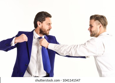 Young men in formal wear or businessmen fight with tie, isolated on white background. Boss and employee with aggressive expression fight. Business conflict concept. Businessmen fighting at workplace.