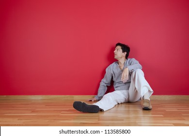 young men relaxing in the floor of his new house