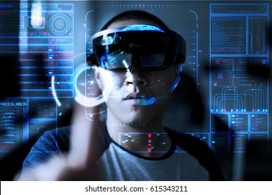 Young  men trying Virtual Reality or augmented reality with HoloLens headset