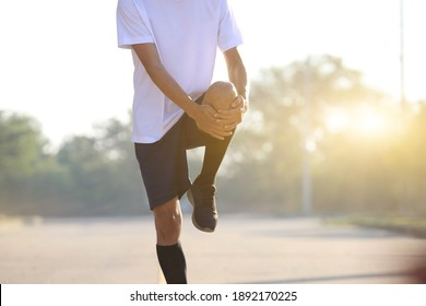 Young men warm up to run