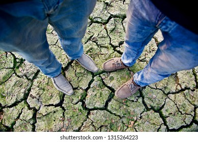 Young men wearing shoes standing on a soil surface unique photo