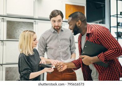 Young men and woman  discuss using laptop, digital tablet in the office. Business, technology,communication, startup,break and people concept.Working atmosphere. Happy multiracial creative team