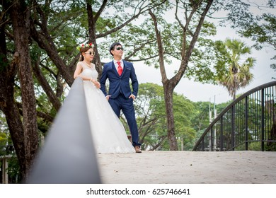 Young men and young women Couple together standing on the bridge.