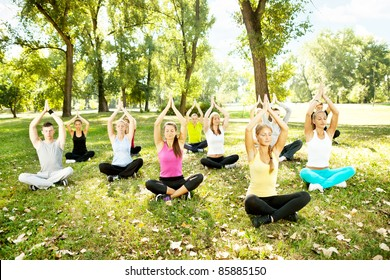 young men and women doing yoga outdoor