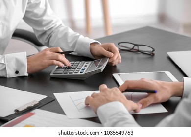 Young men working in office. Consulting service concept