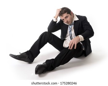 Young Messy Business Man worried and depressed sitting on the floor isolated on white background in stress because of financial crisis