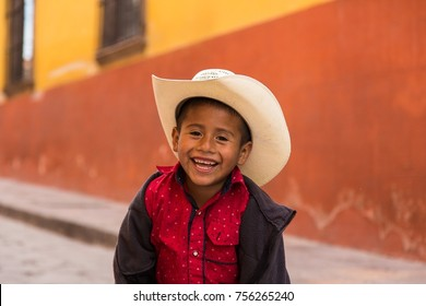 Young Mexican boy laughing on the streets of San Miguel de Allende, Mexico in late January 2017.