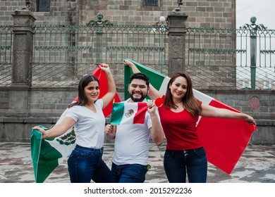 Young mexican people holding some flags in Mexico City