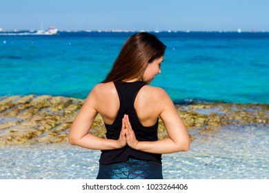 Young mexican woman doing Namaste behind her back. Yoga nature Spa. Yoga  retreat at 89e8c0ab5f631
