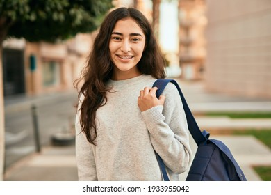 Young middle east student girl smiling happy standing at the city.