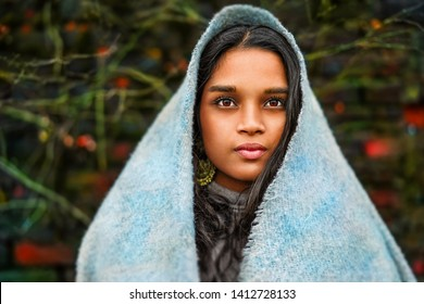 Young middle Eastern woman with scarf and beautiful eyes. Pretty teenager girl with veil.