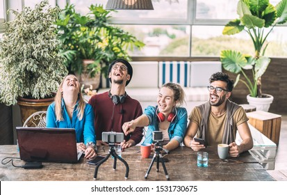 Young millenial friends sharing creative content online - Digital marketing concept with next generation influencer having fun on air with radio video stream - Vlogging time at startup coworking space