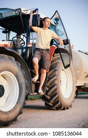 Young millennial farmer on his tractor