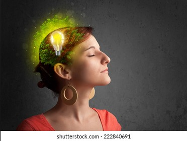 Young mind thinking of green eco energy with lightbulb on grungy background