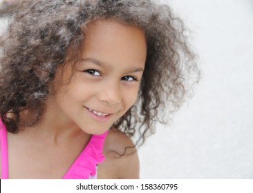 young mixed race child smiling , head shot