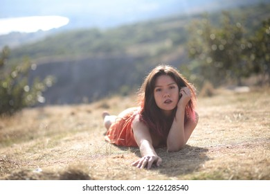 Young mixed race (Chinese/Caucasian) woman in the hills above Cheddar, in Somerset, England.