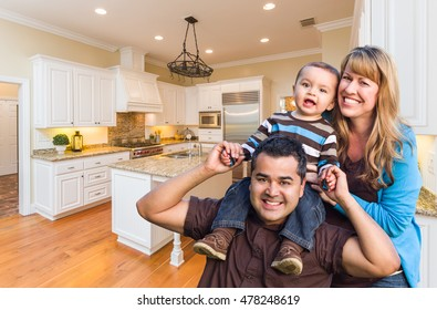 Young Mixed Race Family Having Fun in Custom Kitchen.