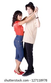 Young mixed-ethnic couple dancing.