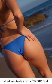 young model in the beach with blue bikini
