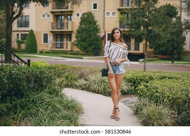 young model brunette walks the streets of Florida and posing for photos