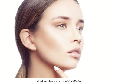 Young model girl with natural make-up and green eyes. Beauty skin care concept