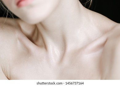 Young Model Neck Half Face Chin and Chest Skin. Healthy Glamour Cosmetic Makeup Cropped Jaw Shoulders Scrag Lady Woman Supermodel for Advertising Body Cream Closeup Horizontal Photo