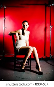 A young model posing in the studio, with styled outfits.
