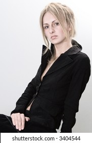 Young model sitting in black dress