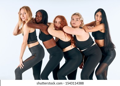 Young models of different sizes, nationalities, hairs. Model plus size, slim girls isolated over white background