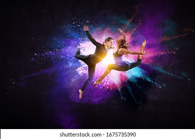 Young modern ballet dancers in a jump. Mixed media