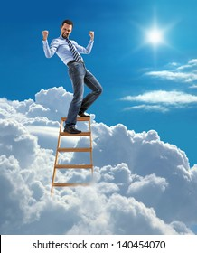 young modern businessman excited with his success standing at the top of ladder high in the sky