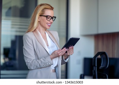 Young modern businesswoman holding tablet.
