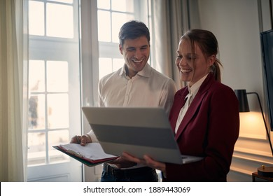 Young modern couple preparing for a business meeting together
