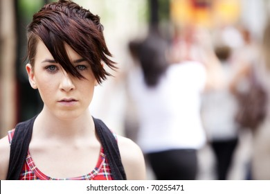 Young modern looking girl over urban background