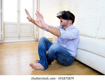 young modern man at home living room sofa couch excited using 3d goggles watching 360 virtual reality vision enjoying the fun cyber experience in vr simulation reality concept