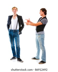 Young modern man pointing on his friend. Isolated on white