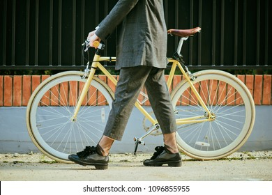 Young modern woman riding a bicycle in the city.