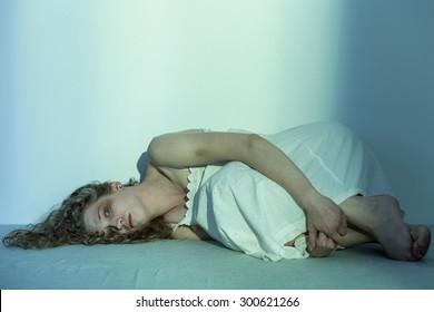 Young molested woman lying on the floor