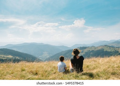 Young mom with baby boy travelling. Mother on hiking adventure with child, family trip in mountains. National Park. Hike with children. Active summer holidays.