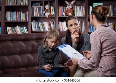 Young mom with her daughter at psychologist consultation