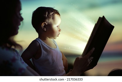 Young mom reading a book